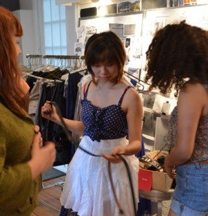 Youth Design girls trying on new fashions.